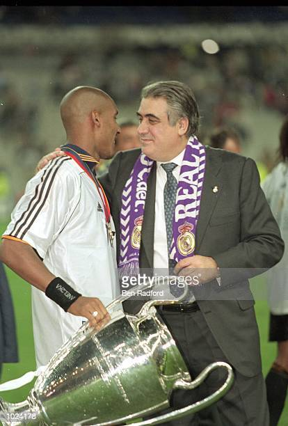 Real Madrid President Lorenzo Sanz and Real Madrid player Nicolas Anelka celebrate after the European Champions League Final 2000 against Valencia at...