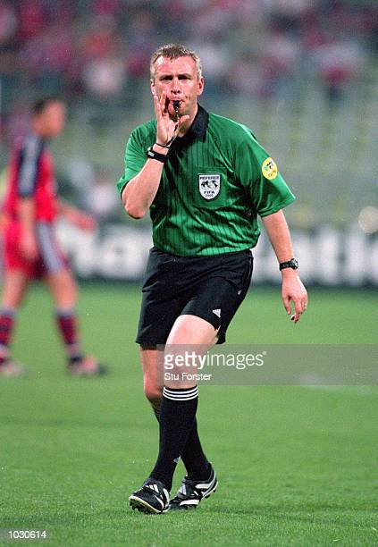 Referee Graham Poll blows his whistle during the Champions League semifinal second leg between Bayern Munich and Real Madrid at the Olympic Stadium...