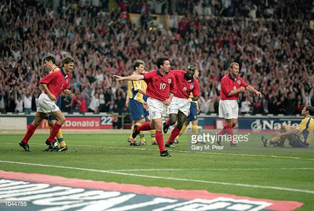 Robbie Fowler of England celebrates after scoring the first goal during the International Friendly between England and the Ukraine at Wembley Stadium...