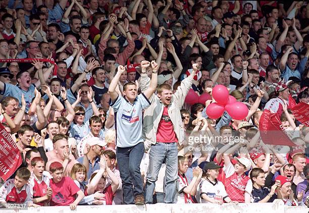 Rotherham fans celebrate promotion to Division 2 after the Nationwide Division 3 game against Swansea at Millmoor in Rotherham England The game was...