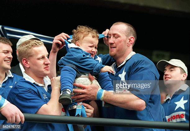 20 May 2000 St Mary's captain Trevor Brennan puts his son Daniel 20 months in the AIB League Cup after his side defeated Lansdowne in The AIB League...