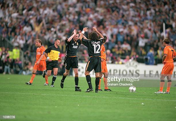 Steve McManaman celebrates with his Real Madrid teammate Ivan Campo after scoring during the European Champions League Final against Valencia at the...