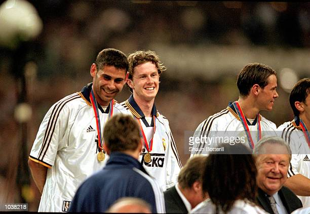 Steve McManaman celebrates with his Real Madrid teammates after winning the European Champions League Final against Valencia at the Stade de France...