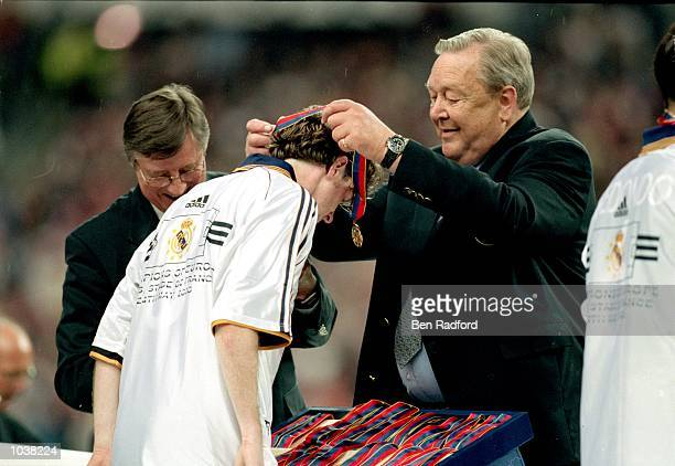 Steve McManaman of Real Madrid collects his winners medal after winning the European Champions League Final against Valencia at the Stade de France...