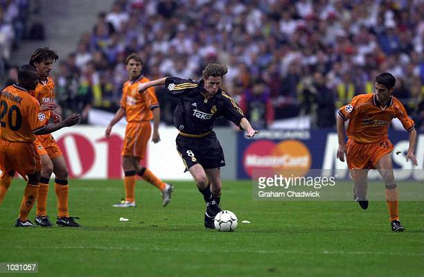 Steve Mcmanaman of Real Madrid goes through the Valencia defence during the match between Real Madrid and Valencia in the UEFA Champions League Final...