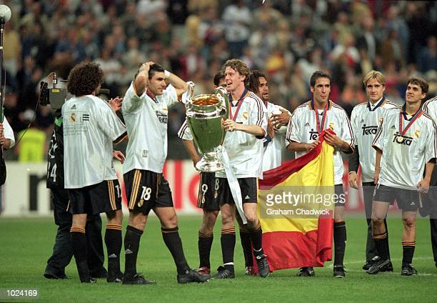 Steve McManaman of Real Madrid holds the trophy while celebrating with the other players after the European Champions League Final 2000 against...