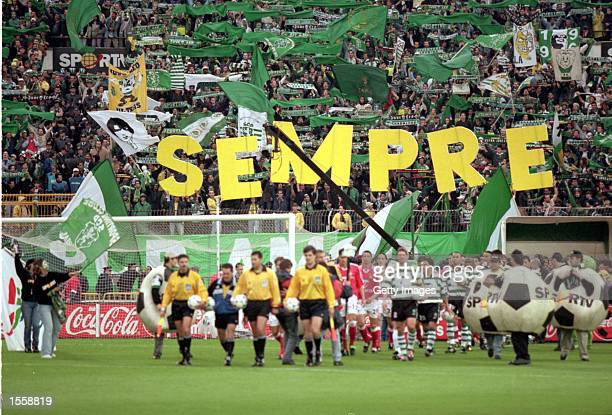 Teams led out before the Portuguese 1 Liga match between Sporting Lisbon and Benfica at the Jose de Alvalade Stadium Lisbon Portugal Benfica won 10...