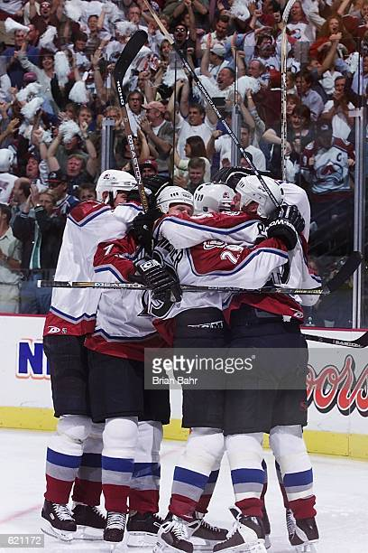 The Colorado Avalanche celebrate a goal against the Detroit Red Wings during game five of the Western Conference Semifinals at the Pepsi Center in...