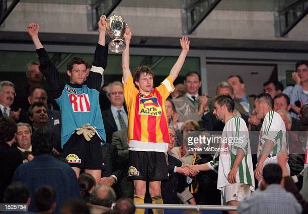 The two captains Mickael Landreau of Nantes and Reginald Becque of Calais after Nantes win the French Cup Final at the Stade de France in St Denis,...