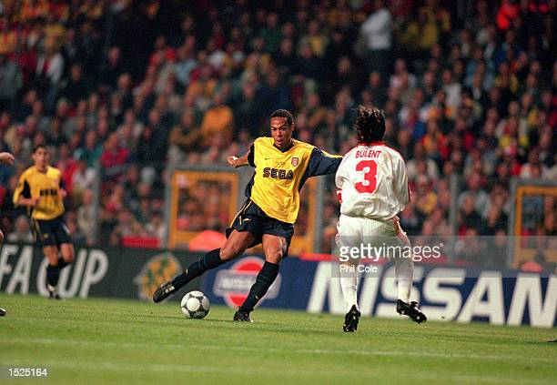 Thierry Henry of Arsenal takes on Bulent Korkmaz of Galatasaray during the UEFA Cup final at the Parken Stadium in Copenhagen, Denmark. The match...