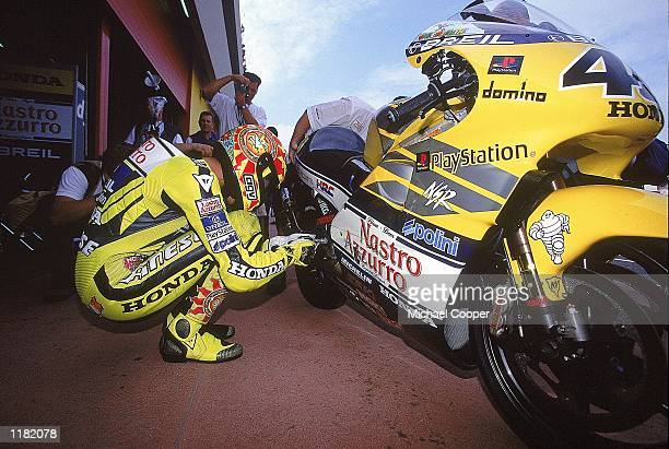 Valentino Rossi makes last minute adjustments to his Honda before the Italian Motorcycle 500cc Grand Prix at Mugello in Italy. \ Mandatory Credit:...