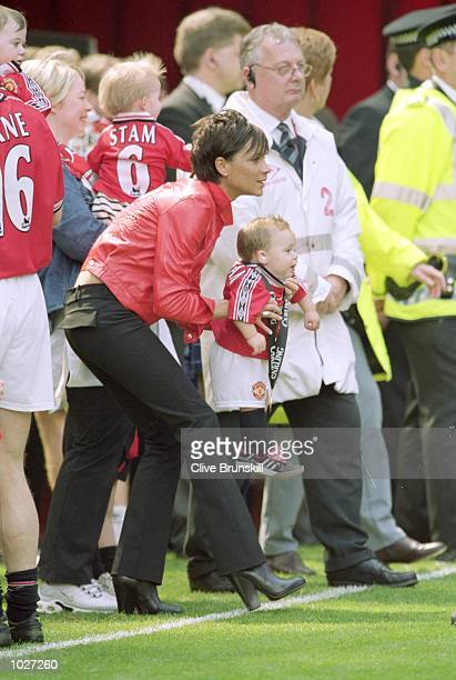 Victoria ''Posh Spice'' Beckham with son Brooklyn celebrating Manchester United's championship win after the FA Carling Premiership match against...