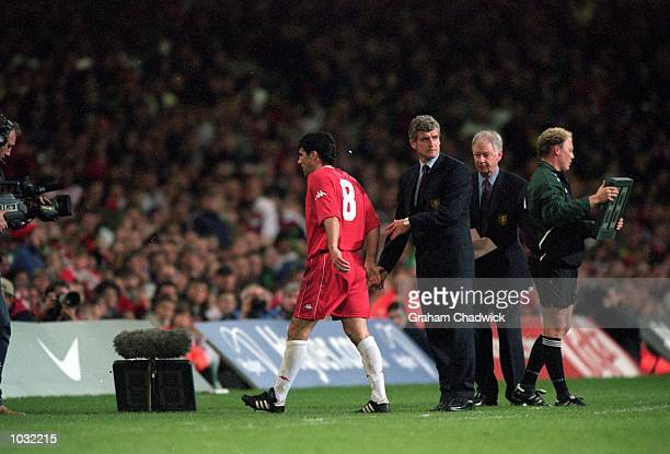 Wales manager Mark Hughes substitutes Dean Saunders during the International Friendly match against Brazil at the Millennium Stadium in Cardiff Wales...