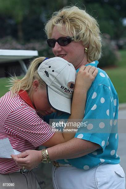 Yearold golfer Morgan Pressel, who qualified for the U.S. Women's Open on May 31st, rests her head on her Mother Kathy after practied today at St....