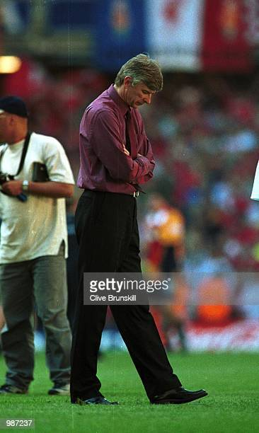 A dejected Arsenal manager Arsene Wenger after the AXA sponsored 2001 FA Cup Final between Arsenal v Liverpool at the Millennium Stadium Cardiff...