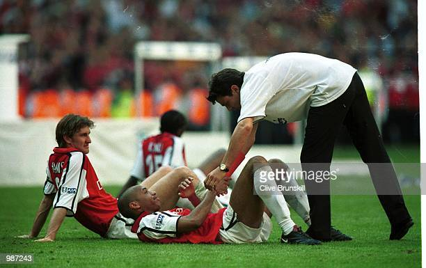 A dejected Thierry Henry of Arsenal is consoled by Jari Litimun after the AXA sponsored 2001 FA Cup Final between Arsenal v Liverpool at the...