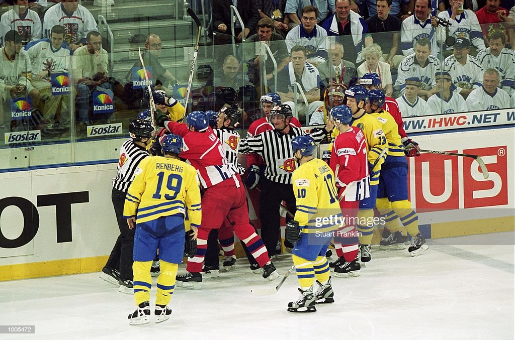 A fight breaks out during the IIHF World Ice Hockey Championships match between Sweden and Czechoslavakia played at the Preussag Arena in Hannover, Germany. \ Mandatory Credit: Stuart Franklin /Allsport