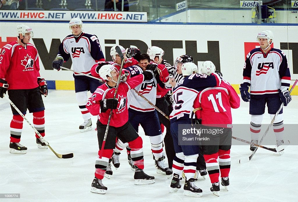A fight breaks out during the IIHF World Ice Hockey Championship Quater-final match between USA and Canada held at the Preussag Arena in Hanover, Germany. \ Mandatory Credit: Stuart Franklin /Allsport