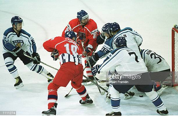 Goalmouth scramble between Czechoslovakia and Finald during the World Ice Hockey Championships in Hanover, Germany. Mandatory Credit: STUART...
