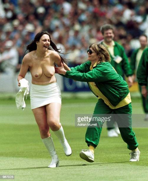 A streaker runs past the players during the fourth days play in the npower First Test Match between England and Pakistan at Lords Cricket Ground...