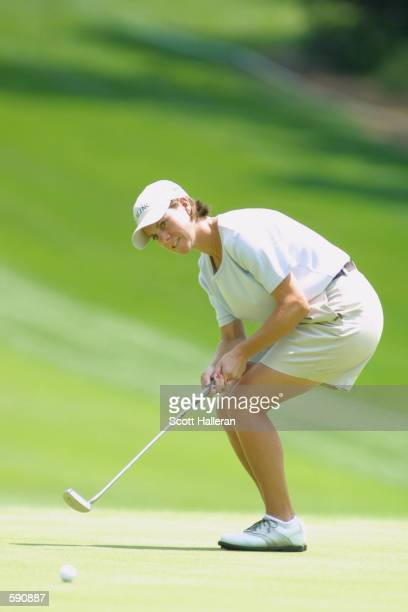 AJ Eathorne of Canada urges a par putt to drop on the 18th hole at Pine Needles Lodge Golf Club during the first round of the 2001 US Women's Open in...