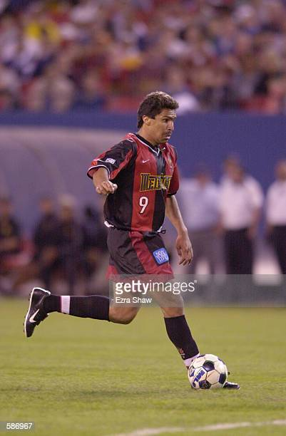 Alex Comas of the New York / New Jersey MetroStars dribbles down field against the Los Angeles Galaxy during the match at Giants Stadium in East...