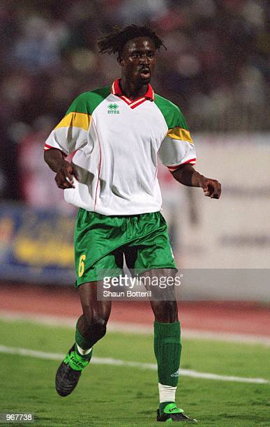 Aliou Cisse of Senegal in action during the FIFA World Cup 2002 Qualifying match against Egypt played at the National Stadium in Cairo Egypt Egypt...
