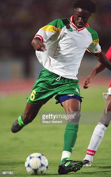 Aliou Cisse of Senegal runs with the ball during the FIFA World Cup 2002 Qualifying match against Egypt played at the National Stadium in Cairo Egypt...