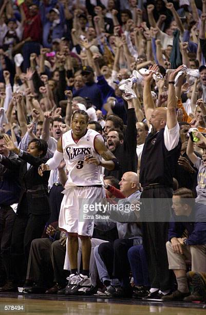 Allen Iverson of the Philadelphia 76ers celebrates from the sideline in game one of the eastern conference finals against the Milwaukee Bucks at the...