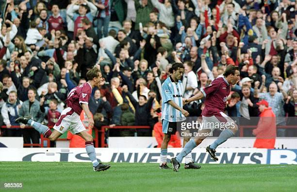Aston Villa's Paul Merson celebrates the third goal as Coventry's Moustapha Hadji looks on in dispair during the FA Carling Premier League game...