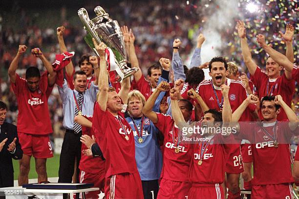 Bayern Munich Captain Stefan Effenberg lifts the trophy to the delight of his team mates after the Uefa Champions League Final win against Valencia...