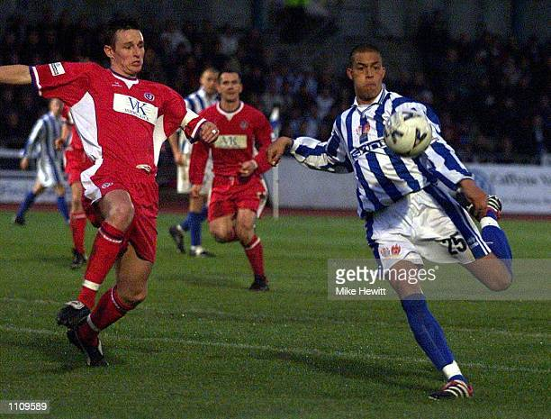 Bobby Zamora of Brighton shoots just wide under pressure from Ian Breckin of Chesterfield during the match between Brighton and Hove Albion and...