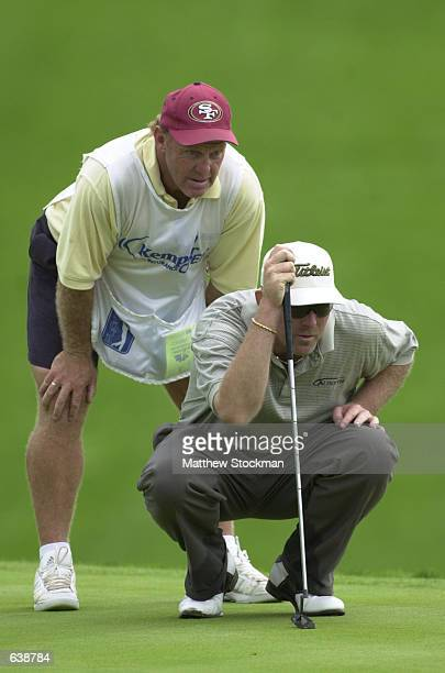 Caddy Tony Lingard helps Frank Lickliter line up a putt on the 16th green during the resumption of the fourth round of the Kemper Insurance Open at...