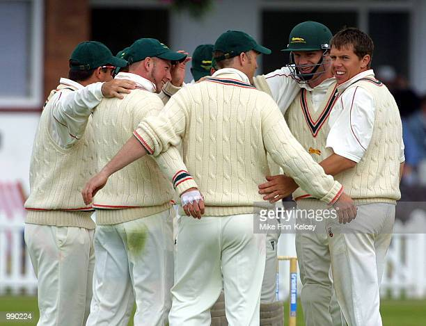Carl Crowe of Leicestershire celebrates with teammates after dismissing Michael Burns of Somerset for 60 in the CricInfo County Championship match at...