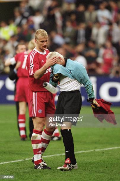 Carsten Jancker of Bayern Munich consoles Valencia Goalkeeper Santiago Canizares after the Uefa Champions League Final between Bayern Munich and...
