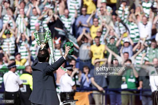 Celtic manager Martin O''Neill celebrates with the trophy after winning the Tennets Scottish FA Cup Final between Celtic v Hibernian at Hampden Park...