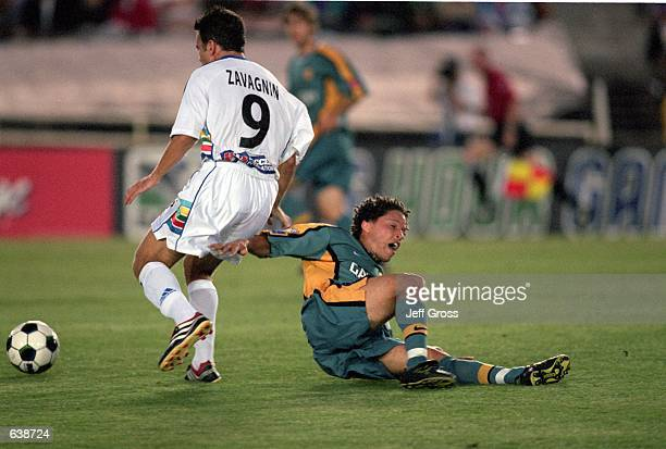 Cobi Jones of the Los Angeles Galaxy ihits the ground against Kerry Zavagnin of the Kansas City Wizards during the game at the Rose Bowl in Pasadena...