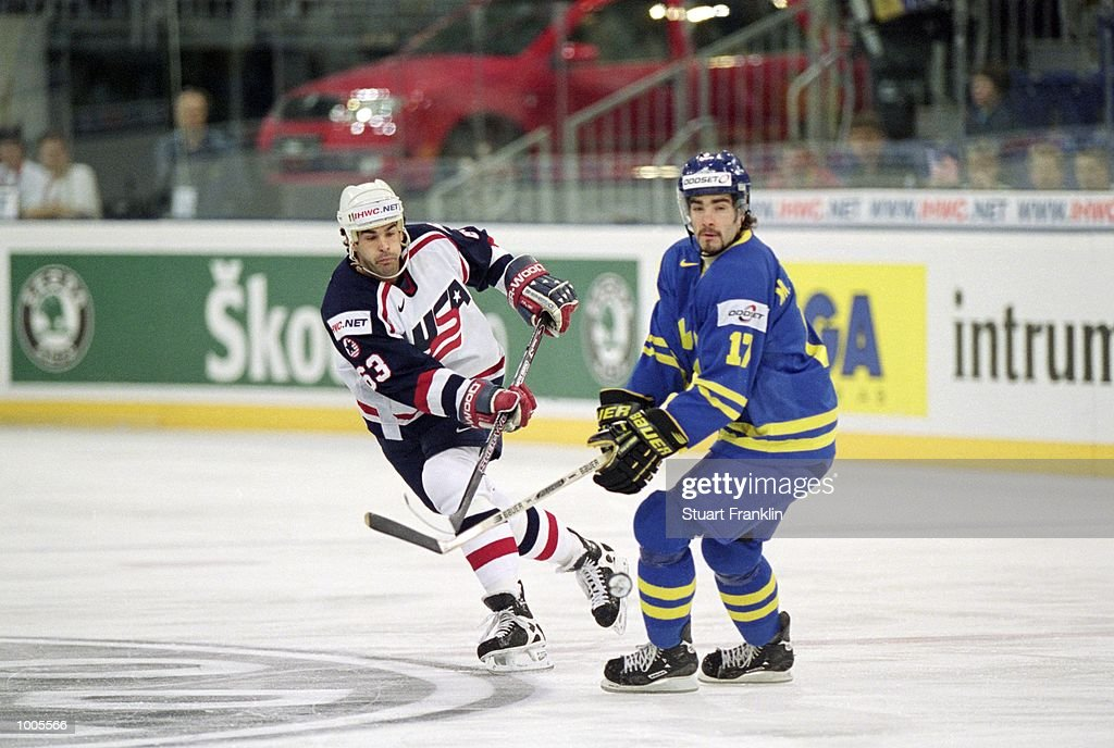 Craig Darby of USA and Mathias Johansson of Sweden in action during the IIHF World Ice Hockey Championship Third place play-off match between Sweden and the USA played at the Preussag Arena in Hannover, Germany. \ Mandatory Credit: Stuart Franklin /Allsport