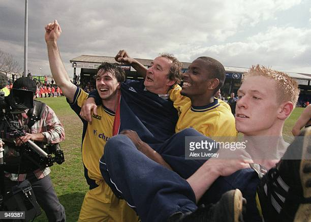 Crystal Palace caretaker manager Steve Kember is lifted up by his jubilant players Dougie Freedman , Clinton Morrison and Mikael Forssell after...