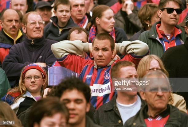 Crystal Palace fans feel the tension and pain during the Nationwide League Division One match against Stockport County played at Edgeley Park, in...