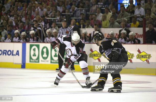 Curtis Brown of the Buffalo Sabres tries to get past Jaromir Jagr of the Pittsburgh Penguins during game 7 of the Eastern Conference Semi Finals of...