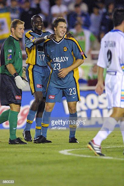 Danny Califf of the Los Angeles Galaxy and teammates Ezra Hendrickson, and Matt Reis celebrate the win over the Kansas City Wizards at the Rose Bowl...