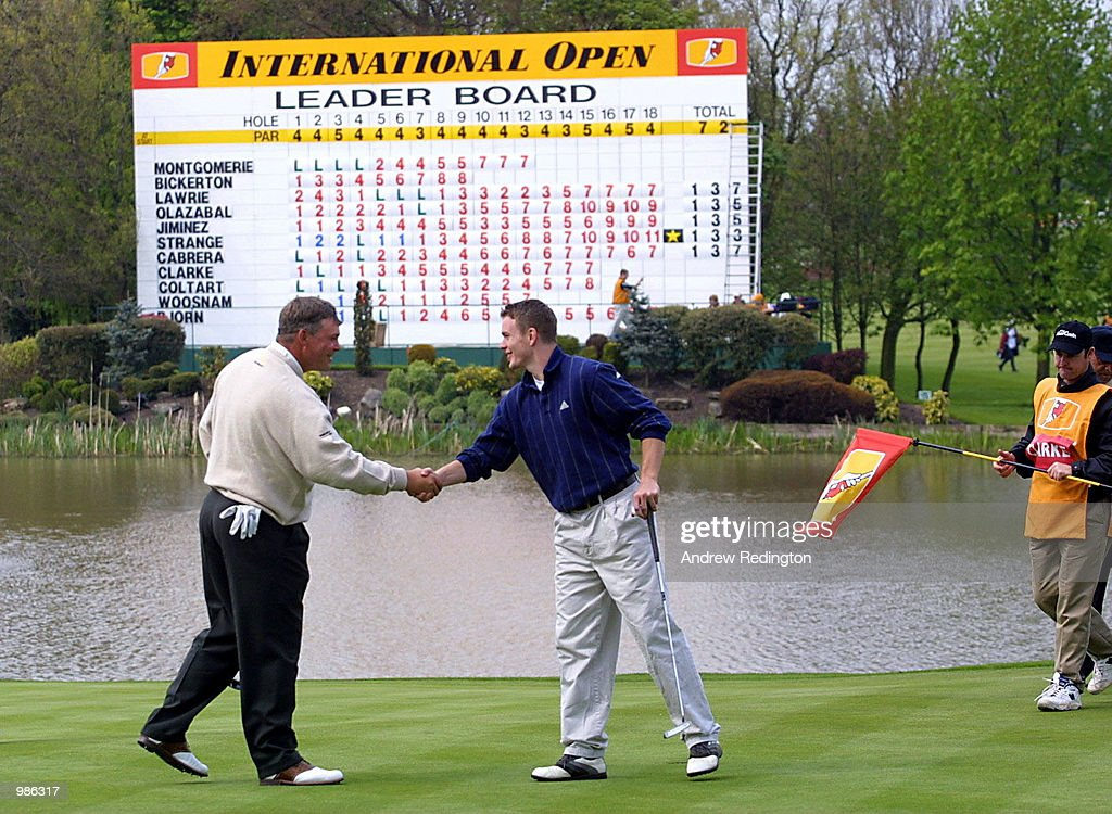 Darren Clarke of Northern Ireland shakes hands with Rugby player Matt Perry after the Pro-Am event at the Benson & Hedges International Open held at the Belfry, Birmingham. Mandatory Credit: Andrew Redington/ALLSPORT