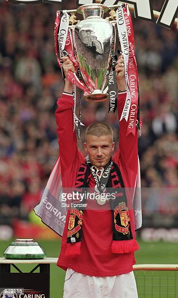 David Beckham of Manchester United lifts the league title after the FA Carling Premiership match against Derby County played at Old Trafford in...