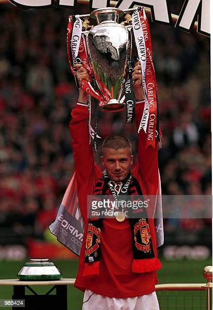 David Beckham with the FA Carling Premiership trophy aftre the FA Carling Premiership match between Manchester United and Derby County at Old...