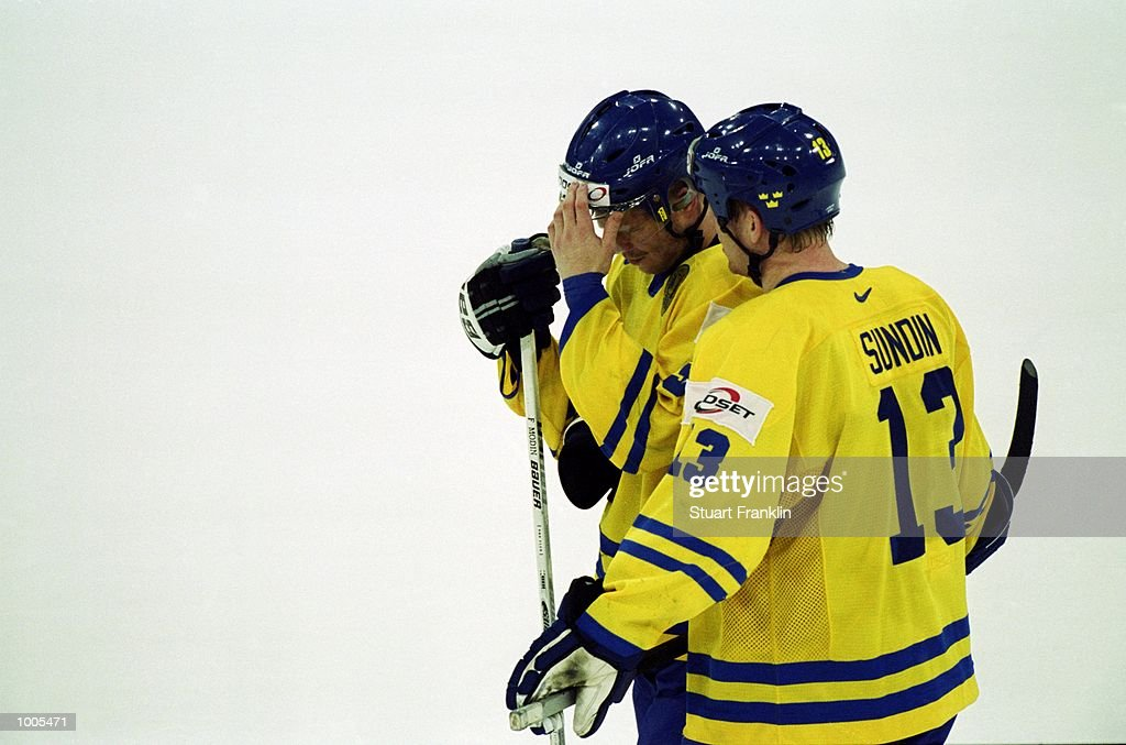 Dejected Sweden players console each other after the IIHF World Ice Hockey Championships match against Czechoslavakia played at the Preussag Arena in Hannover, Germany. \ Mandatory Credit: Stuart Franklin /Allsport