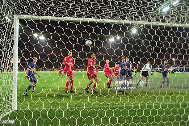 Delfi Geli of Deportivo Alaves scores a golden goal own goal in extratime to hand Liverpool a 54 victory in the UEFA Cup Final at the...