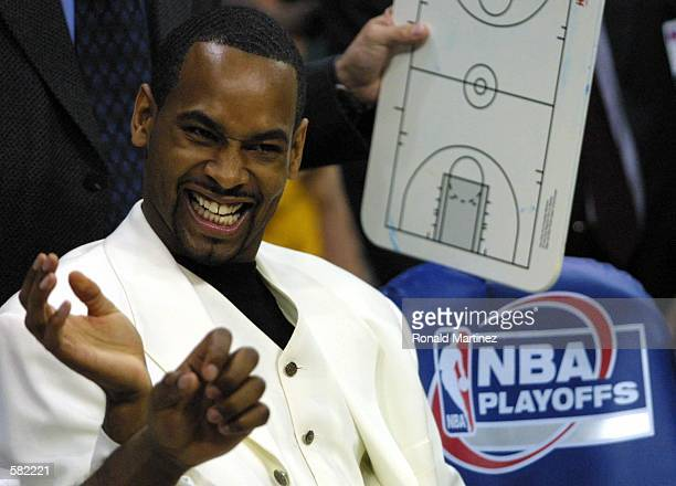 Derek Anderson of the San Antonio Spurs smiles while sitting on the bench before Game 4 of the second round of the NBA playoffs against the Dallas...
