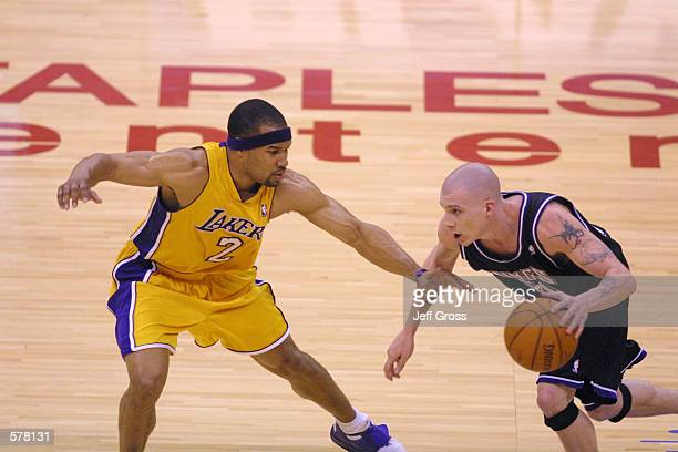 Derek Fisher of the Los Angeles Lakers defends Jason Williams of the Sacramento Kings during game one of the NBA western conference semifinals at the...