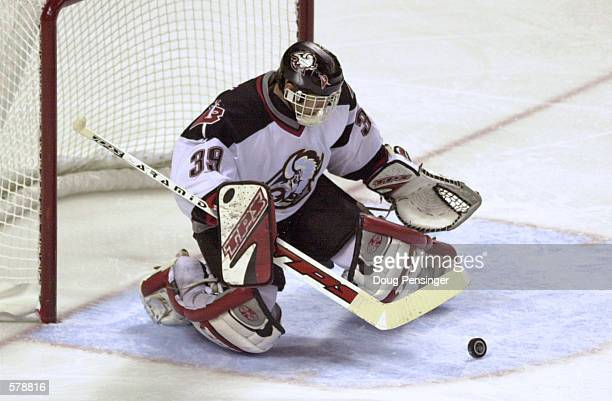 Dominik Hasek of the Buffalo Sabres makes a save against the Pittsburgh Penguins as the Sabres defeated the Penguins 32 in overtime in game five of...